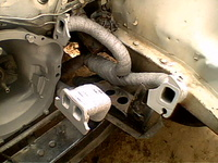 1969 Toyota Corolla Coupe, Two 2into1 headers fashioned from a 4into1. Heat wrapped and ready for the new engine