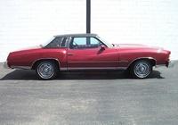 1974 Chevrolet Monte Carlo Maroon w/ Black Landeau top.