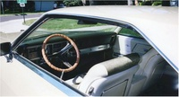 1968 Buick Riviera, View of the dashboard and front seats through the driver's side window, interior