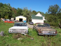 1961 Chevrolet Impala, The brown one was his parts car. It's actually the better car it a grandmas car parked for a new model it has 61,000 miles. he took the engine out but I found it all.