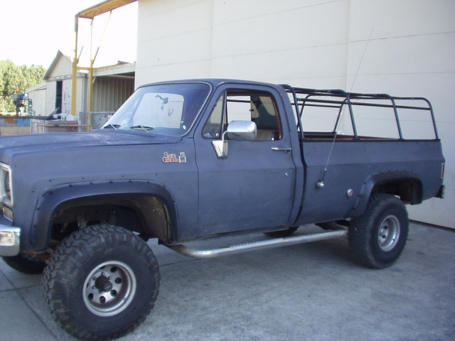 1975 GMC Sierra, My east with my senior project mounted on the bed. A folding Canvas covered camper shell frame.