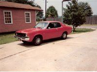 1975 Dodge Colt, this was my first car.It was originally gold,but I painted it red & fixed it up.Had just put in a brand new engine when I got rid of it.