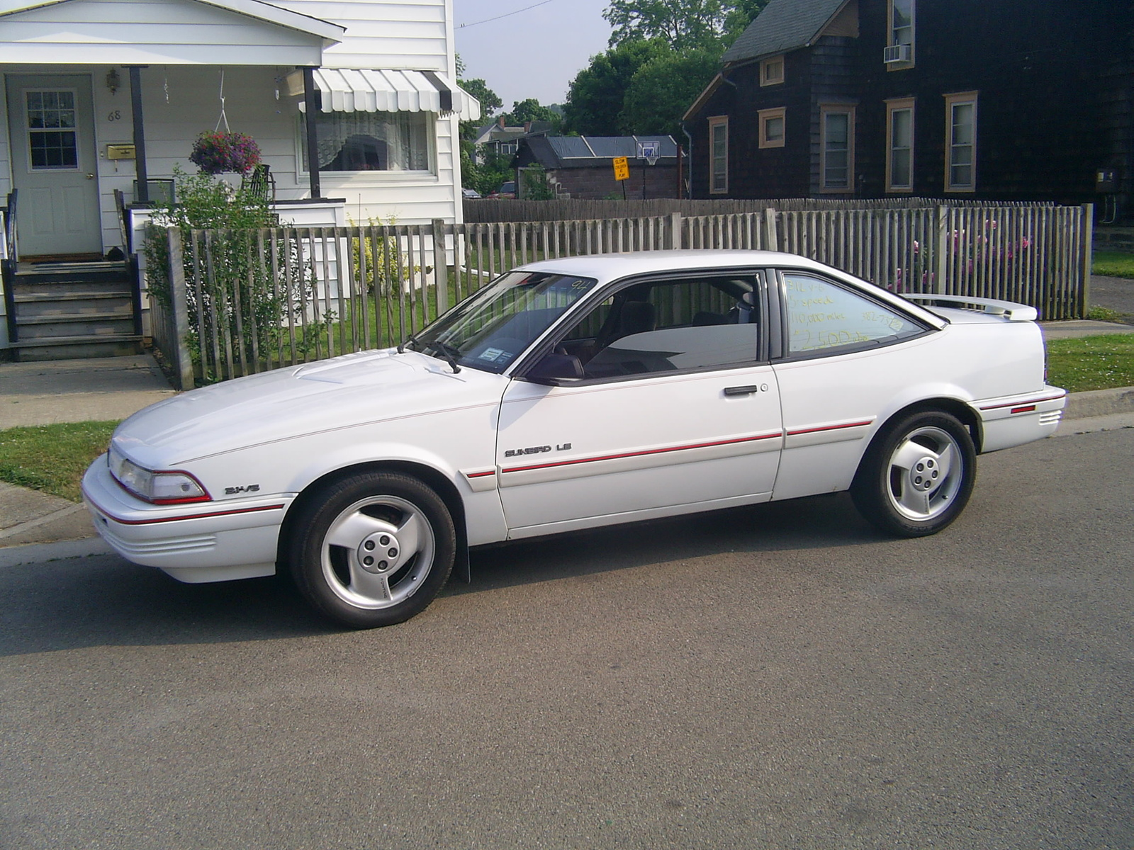 picture of 1994 pontiac sunbird 2 dr le coupe