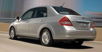 2009 Nissan Versa, Sedan Back Left Quarter View, manufacturer, exterior