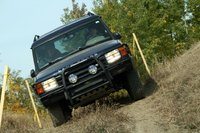 1998 Land Rover Discovery, My wife participating in her first trials course. In fact it was her first time off-road ever and she did fantastic.   Don't really get to drive the truck anymore no...