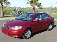 2003 Toyota Corolla CE, Belongs in a suburban driveway surrounded by toddler toys., exterior