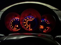 2006 Mazda MAZDA3 s Touring, The red backlighting creates an interesting glow at night., interior, gallery_worthy