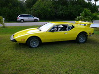 "1974 De Tomaso Pantera, Yellow Pearl paint Out for a wash.. Go to Pantera International Website to see more of these great cars... Rumors say ""Look for a new one in the Geneva car show in 201..."