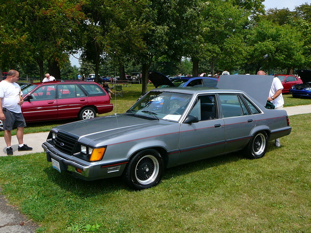 1985 Ford LTD, At a day in the Park. I have the mesh ARE's off the Capri on it. I've done a MAJOR detailing job. Sanded & repainted the front end trim in semi gloss black. The ...