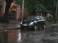 2005 Suzuki Swift, My car in front of Ram Krishna Mission.... All drenched in heavy rainfall....but looking beautiful nonetheless.., exterior