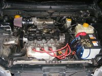 1999 Daewoo Nubira 4 Dr SX Hatchback, Engine bay with all the mods. Grounding Kit. Voltage Regulator. Pulstar Plugs Plasma Plugs. Magnecor 10mm Wires. Home made Short Ram intake with a K&N Fil...