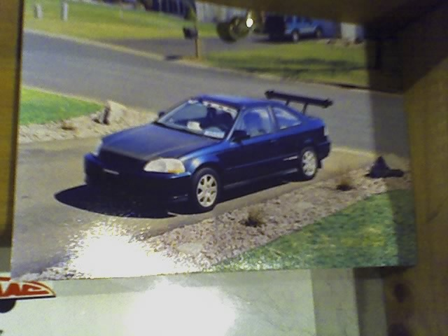 1997 Honda Civic Coupe EX, My suped up 1997 Honda Civic Ex with approx 165 horsepower. I could walk a Honda Civic Si. Carbon fiber hood, aluminum spoiler, Si rims, V-tech controller, 9.8 mm wires, fue...