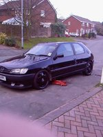 1995 Peugeot 306, got bored of silver rim so stripped to black , exterior
