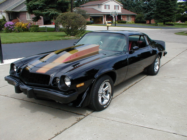1977 Chevrolet Camaro, Features: 4inch raised hood, flip/flop strips on black safire paint, Stockton custom wheels, 350CID,cran cam, Dart heads, headman headers, 350 turbo, 12 bolt posi, custom black ...