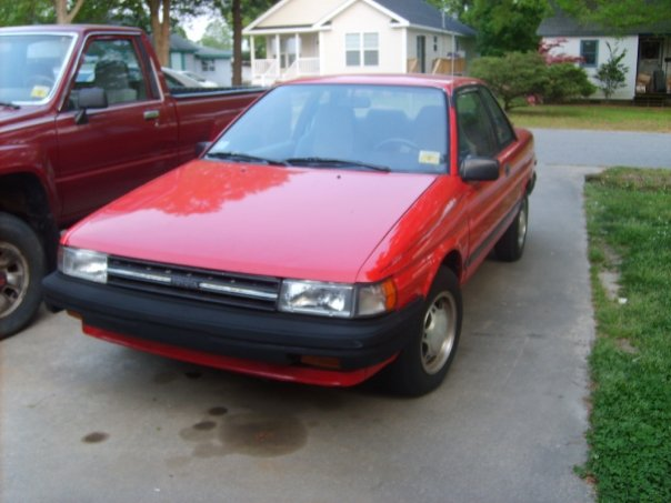 1988 Toyota Tercel, my baby, a 1988 toyota tercel dx front side view coupe with luggage rack is the sport model for this year sports an AM/FM radio and a cassette tape player heating and AC (however A...
