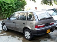 1996 Suzuki Cultus, hmm... & thts my nana's Charade behind it. Pretty beat up!! Poor thing... lolz, exterior
