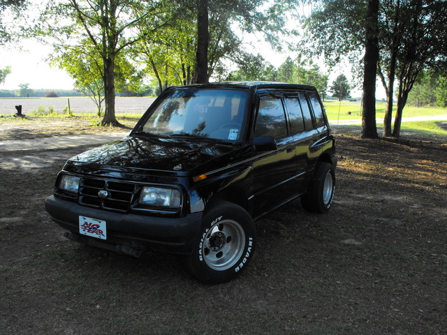 Picture of 1997 Geo Tracker 4 Dr STD 4WD SUV, exterior