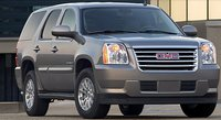 2011 GMC Yukon Hybrid, front three quarter view , exterior, manufacturer