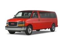 2011 GMC Savana, front three quarter view , manufacturer, exterior