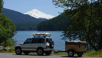 1992 Suzuki Sidekick 4 Dr JX 4WD SUV, Heading to the mountain with an Explorer Box in tow and rooftop tent, exterior