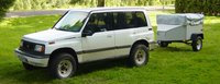 1992 Suzuki Sidekick 4 Dr JX 4WD SUV, Explorer Pod camping trailer all hooked up and ready to go, exterior