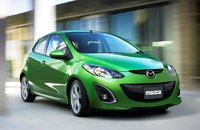 2010 Mazda MAZDA2, Front, right quarter view in motion. , exterior, manufacturer