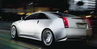2011 Cadillac CTS Coupe, Rear quarter view in motion. , manufacturer, exterior