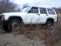 1987 Jeep Cherokee, new front tire waiting for next check to replace the back tires(look at size diff front front and rear, exterior