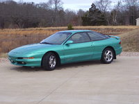 1993 Ford Probe GT, I'm a happy camper. Had a 95 GT w/seafoam and chrome but it got rear-ended new year's eve. I couldn't bury this car in the junk yard so I held on to it. Som...