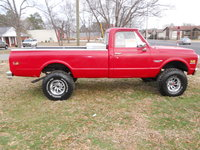 1971 Chevrolet C/K 10, Red paint, has a few dings and scratches on it. The bed is a little rusty and it has a few small rips in the seat inside the cab.  The passenger side mirror has a crack in it fr...