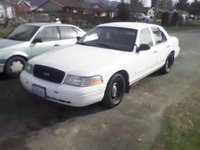 2002 Ford Crown Victoria LX Sport, I took this picture the day I bought it with my cell phone, exterior