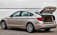 2011 BMW 5 Series Gran Turismo, Back three quarter view with opened trunk., exterior, manufacturer