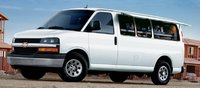 2011 Chevrolet Express Cargo, Side view with compartment storage. , exterior, manufacturer