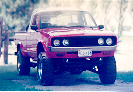 "1978 Datsun 620 Pick-Up, 302 Ford p[owerplant, raised 14"" over stock height and is a 4x4 forgery, exterior"
