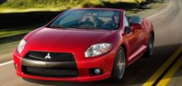 2012 Mitsubishi Eclipse Spyder, Front quarter view in motion., manufacturer, exterior