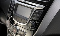 2012 Hyundai Accent, Close-up of stereo., exterior, interior, manufacturer