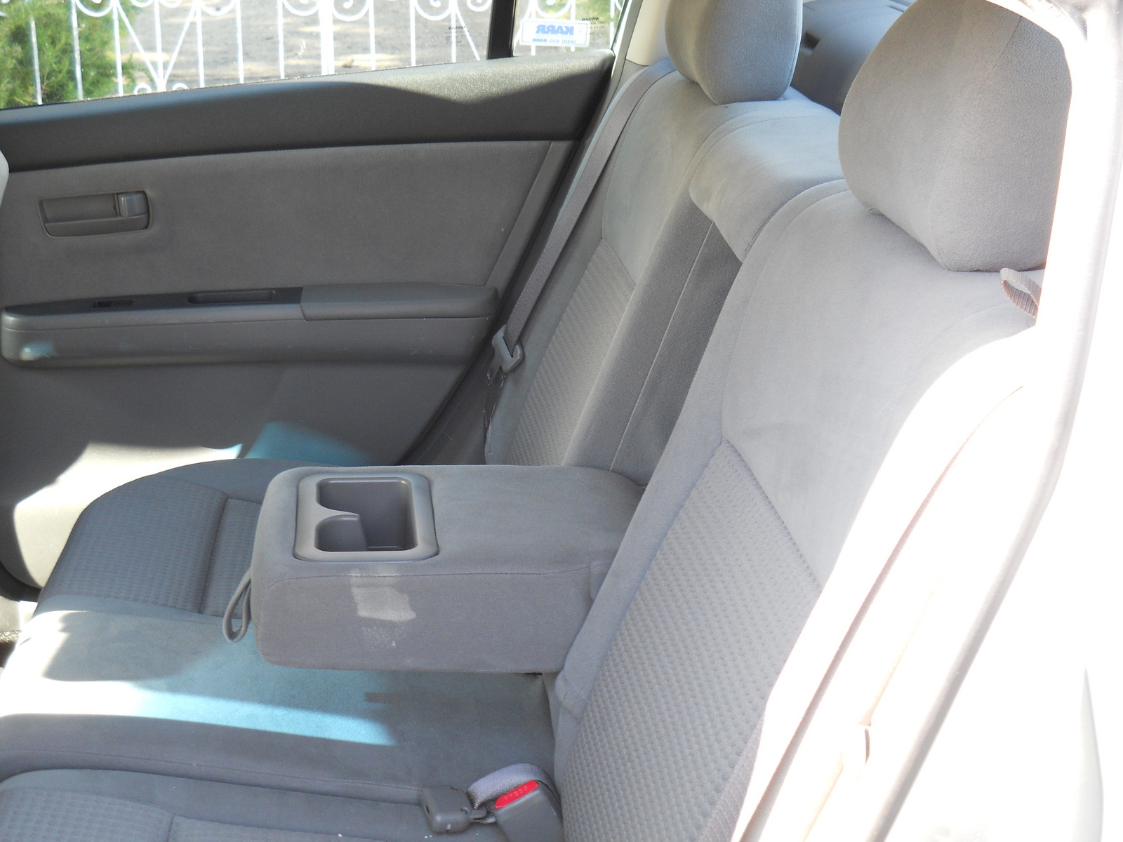 how to put down back seats in nissan sentra 2011