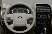 2012 Ford Escape Hybrid, Close-up to steering wheel copyright AOL Autos. , manufacturer, interior