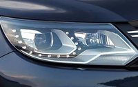 2011 Volkswagen Tiguan, Close-up of headlight. , exterior, manufacturer