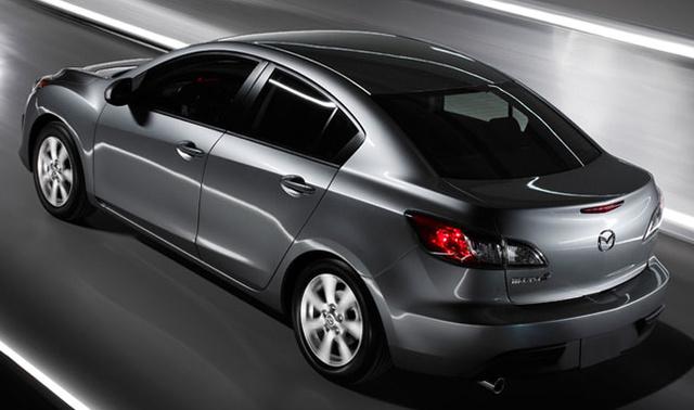 2012 Mazda MAZDA3, Back quarter view., exterior, manufacturer