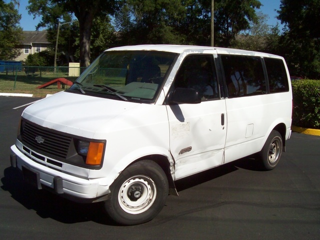 1992 Chevrolet Astro Cargo Van, Here's the dent or smash on the door. You will need to use the close-up tool on this. , exterior