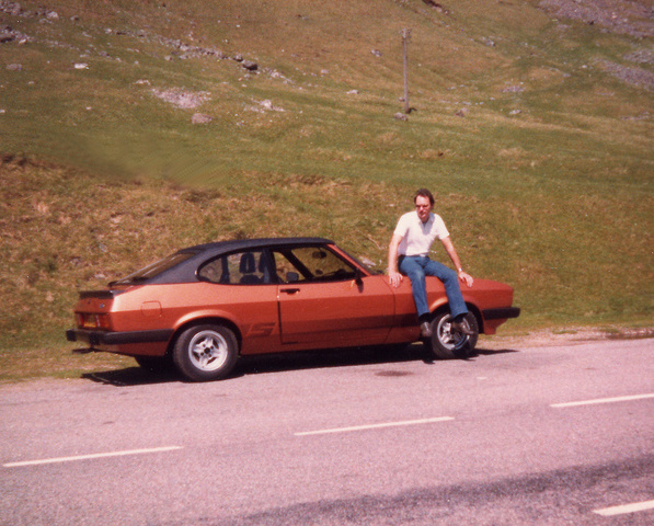 2.0S Ford Capri in Aztec Bronze with X pack suspension, Recaro seats and a twin choke Weber carburettor that made it fly ! I remember racing the 125 m.p.h. train up the A9 road  in Scotland which runs...