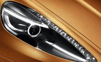 2012 Aston Martin Virage, Close-up of headlight., exterior, manufacturer