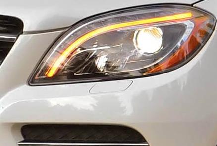 2012 Mercedes-Benz M-Class, Close-up of headlight. , exterior, manufacturer