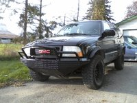 1999 GMC Jimmy 4 Dr SLT 4WD SUV, Project Urban Assault Jimmy. With Gibbys Customz fabricated Stealth front bumper and matching fender flares. , exterior, gallery_worthy