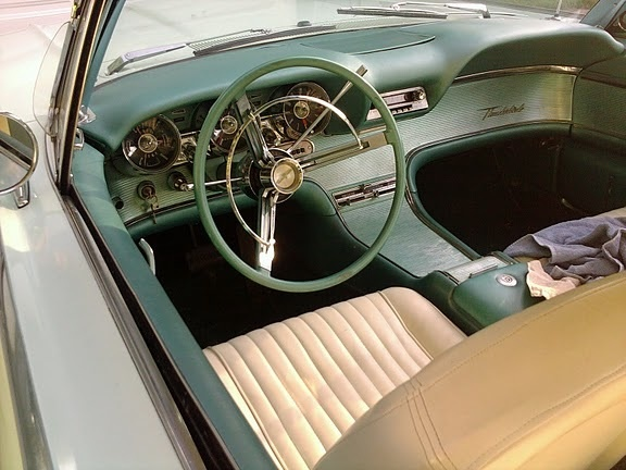 1961 Ford Thunderbird, Interior. These cars were unlike anything - streamlined dashboard and console. Either you love it or hate it, there's nothing in between., interior