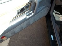 1990 Lincoln Mark VII LSC, Striped door panel trim from the factory that carries over to the floorboards., interior