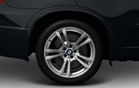 2013 BMW X5 M, Close-up of front tire copyright AOL Autos. , manufacturer, exterior
