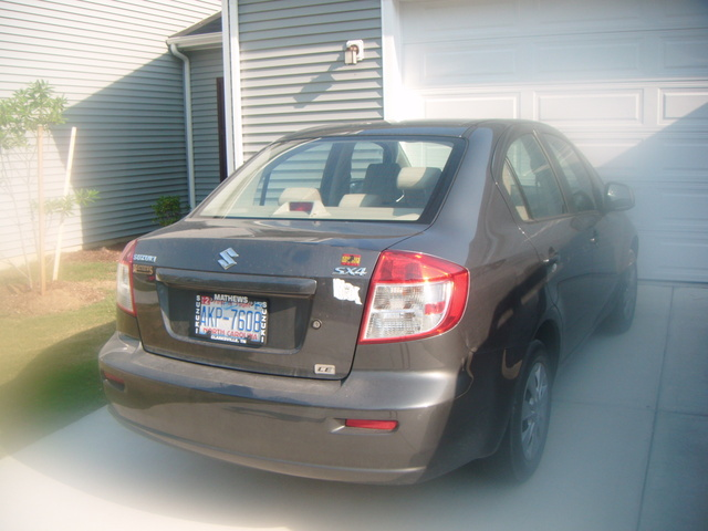 Picture of 2010 Suzuki SX4 LE Popular, exterior, gallery_worthy