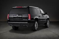 2013 Cadillac Escalade ESV, Rear-quarter view. Copyright General Motors, manufacturer, exterior